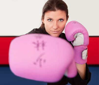 Fierce Woman Punching in Women's Self Defense Classes